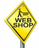 web shop icon online internet shopping concept with text and black shopping cart on yellow road sign