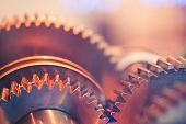 stock photo of interlocking  - gear wheels close - JPG