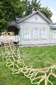 Braided straw on stand near house with terrace in Vologda, Russia
