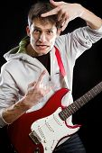 image of stratocaster  - Man with red electric guitar - JPG