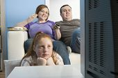 stock photo of obesity children  - Obese family watching television together - JPG