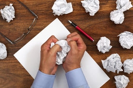 picture of storyboard  - Crumpled paper and businessman tearing up another paper ball for the pile - JPG