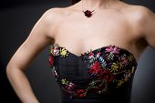 picture of semi-formal  - Closeup photo of a cocktail dress showing flower embroidery details - JPG