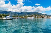 stock photo of crimea  - Scenic summer panorama of Black Sea pier and port harbor in Yalta - JPG