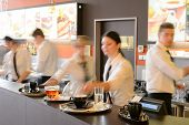 stock photo of waiter  - Busy waiter and waitresses working at bar night - JPG