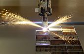 picture of welding  - Plasma cutting process of metal material with sparks - JPG