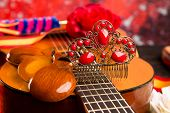 stock photo of castanets  - Classic spanish guitar with flamenco elements as comb and castanets - JPG