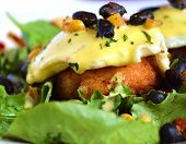 pic of crab-cakes  - eggs Benedict with a black bean salsa on a crab cake with white background - JPG