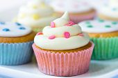 stock photo of cupcakes  - Selection of colorful cupcakes on a plate - JPG