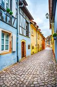 stock photo of petition  - Colmar Petit Venice narrow street and traditional half timbered colorful houses - JPG