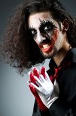 image of joker  - Joker personification with man in dark room - JPG