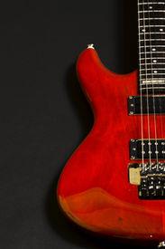 foto of ibanez  - closeup of an electric guitar on black - JPG