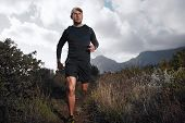 Ultra marathon trail runner with determination exercising for fitness and healthy lifestyle