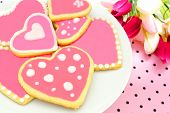 stock photo of poka dot  - Plate of heart shaped cookies with pink frosting - JPG