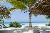 Lounges under umbrella at the shore of Indian ocean, Zanzibar, Tanzania, Africa