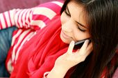 Closeup portrait of a young beautiful woman talking on the phone