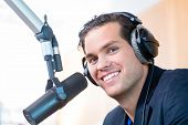 picture of presenter  - Presenter or host in radio station hosting show for radio live in Studio - JPG