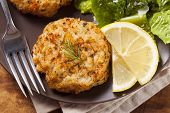 foto of cooked crab  - Organic Homemade Crab Cakes with Lemon and Tartar Sauce - JPG