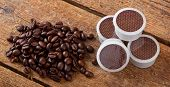pic of bean-pod  - Coffee beans with pods on wooden table - JPG
