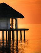 Pavilion on water in dusk, Maldive Islands