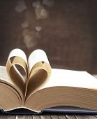 stock photo of bookworm  - Pages Of A Book Curved Into A Heart Shape - JPG