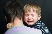 pic of sob  - Crying child in the arms of his father - JPG