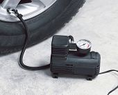 image of air compressor  - Filling air into a car tire by car air compressor - JPG