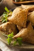 image of samosa  - Homemade Fried Indian Samosas with Mint Chutney Sauce - JPG