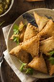 foto of samosa  - Homemade Fried Indian Samosas with Mint Chutney Sauce - JPG