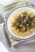 stock photo of morel mushroom  - Top view on a plate with spiral pasta with morel mushrooms - JPG