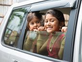stock photo of indian sari  - Asian Indian family going to a vacation - JPG