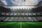 pic of football pitch  - Digitally generated large football stadium under spotlights - JPG