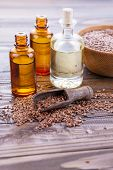 pic of flax seed oil  - Flax seeds oil on wooden background - JPG
