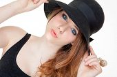 image of pouting  - beautiful fashion teen in makeup and hat - JPG
