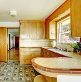 stock photo of linoleum  - Kitchen room with honey rustic storage cabinets linoleum floor and white old appliances - JPG