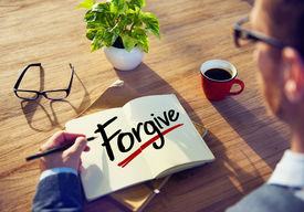 image of forgiveness  - Man with Note Pad and Forgive Concept - JPG