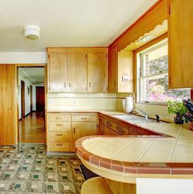 stock photo of linoleum  - Kitchen room with honey rustic storage cabinets linoleum floor and white old appliances - JPG