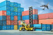 stock photo of weight lifter  - Crane lifter handling container box loading to truck - JPG