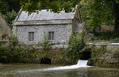 picture of water-mill  - Old mill built of flintstone by Swanbourne Lake in Arundel - JPG