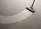 stock photo of strip  - Vacuum cleaner on a carpet with an extra clean strip with copy space - JPG