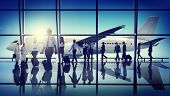 stock photo of cabin crew  - Multiethnic Group of Business People with Airplane - JPG