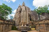 foto of rock carving  - Avukana standing Buddha statue Sri Lanka - JPG