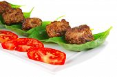 stock photo of veal meat  - grilled french meat balls with tomatoes on white - JPG
