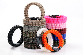 stock photo of paracord  - Parachute cord bracelets of different colors on a white background - JPG