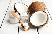 picture of oil well  - Coconut with jars of coconut oil and cosmetic cream on wooden background - JPG