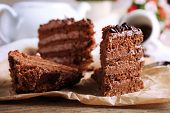pic of tort  - Slices of tasty chocolate cake on plate on table close up - JPG
