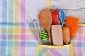 picture of apron  - Set of kitchen utensils in pocket of apron - JPG