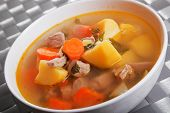 foto of veal  - Veal soup with potatos carrots and onion - JPG