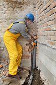 pic of plumber  - Home renovation plumber fixing sewerage pipe at construction site - JPG