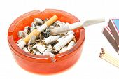 pic of butts  - matches butts and cigarette on white closeup - JPG